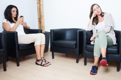 Waiting room. Two women waiting at doctor in waiting room Stock Photos