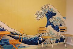 Waiting room with wall painting. The great wave. Norway. royalty free stock photo