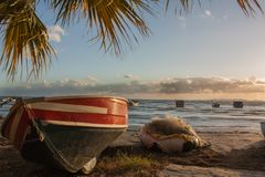 Waiting on the sand at the beach boat. palm leaves cloudy sunset. Waiting on the sand at the beach boat. palm leaves cloudy sunset royalty free stock photos
