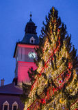Waiting for Santa Claus. Clock measuring time left until Santa Claus gets down the chimney, at dusk, in old city of Brasov, Romania Stock Photo