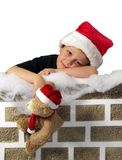 Waiting on Santa white background. A young boy leaning on a chimney waiting for santa claus to arrive Stock Photography