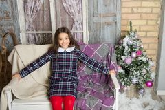 Waiting for santa. Xmas. Cute little child girl with xmas present. happy new year. Christmas shopping. christmas family stock photography
