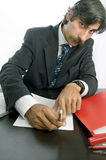Waiting for a signature. Businessman waiting for a signature Stock Image