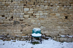 Waiting for the snow. This chair has been waiting whole winter for the snow, and finally got it stock images