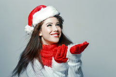 Waiting for the snow falling. Young beautiful woman waiting for the snow falling Royalty Free Stock Image