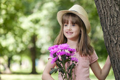 She is waiting for someone and wants to surprise her with a beau Royalty Free Stock Photography
