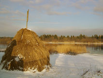 Waiting for spring. Countryside,early,forest,fresh air,grass,hay,hayrick,haystack,landscape,morning,narva,estonia-russia frontier,reed,river,bank,rural,seasons Royalty Free Stock Photo