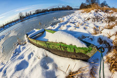 Waiting for Spring. Boat on the river. Royalty Free Stock Photography