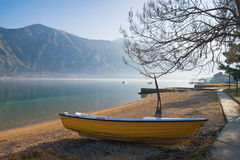 Waiting for spring. One boat on the shore of the Kotor Bay Adriatic Sea on a winter day. Montenegro Stock Image