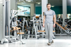 Waiting student. Young sports instructor stands at the fitness c Royalty Free Stock Image