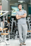 Waiting student. Young sports instructor stands at the fitness c Royalty Free Stock Photos