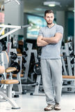 Waiting student. Young sports instructor stands at the fitness c Stock Images