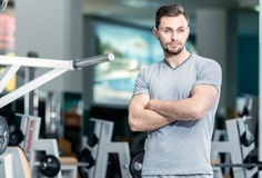 Waiting student. Young sports instructor stands at the fitness c Royalty Free Stock Photography