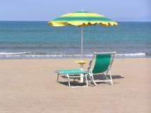 Waiting for the Summer. Deckchair and sunshade on an italian beach in springtime Stock Photography