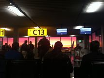 Waiting. Sunrise at Schiphol Airport ,waiting for boarding Royalty Free Stock Image
