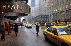 Waiting for a taxi on East 42nd Street, New York. Royalty Free Stock Images