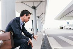 Waiting for taxi. Elegant man waiting for taxi at the airport Royalty Free Stock Images