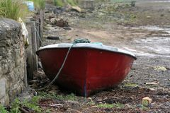 Waiting for the tide. Smal rowing boat is moore to the quay is wating for the tide to come in Royalty Free Stock Photo