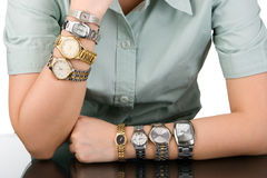 Waiting time concept. A woman hand wearing four watches on each hand and showing all the time of major cities in the world. Just a concept that that woman has Stock Photo