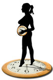Woman standing. Dark silhouette of young woman with pony tail standing tip toe on a clock face and holding a similar clock, white background royalty free stock photography