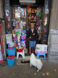 Shopkeeper and her dog Stock Image