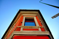 Waiting to see you at the window. Colored house with a nice window in a blue sky Royalty Free Stock Photography