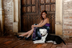 Waiting together, young woman with her dog Stock Photos