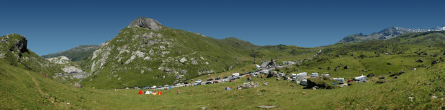 Waiting for the Tour de France. Spectators getting ready for the Tour de France in the Alps Royalty Free Stock Image