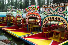 Waiting for Tourists-Xochimilco. Photo of punting barges at Xochimilco in Mexico City.  A one hour trip costs $40 US Royalty Free Stock Photography