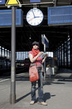 Waiting for the Train. Young woman is waiting for the train and has map in her hands Royalty Free Stock Image