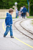 Waiting for train. Little boy waiting for a train Royalty Free Stock Photography
