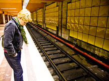 Waiting for train. Woman waiting in underground terminal for subway train Stock Image