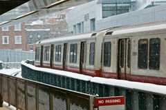 Waiting for the train. Waiting on the train platform at charles street station during a snow storm in boston massachusetts Stock Photography