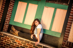 Waiting on the Train. An Attractive Young Lady sitting outside a Train Station Stock Images