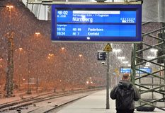 Waiting for train during heavy snow fall royalty free stock photos