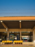 Waiting for a train at trainstation. PHOTHARAM, THAILAND - JANUARY 2, 2017: People waiting for their train on the platform at Photharam  trainstation Royalty Free Stock Image