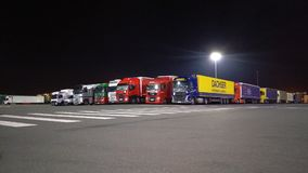 Waiting trucks. Lorries, trucks and commercial vehicles waiting to board the cross channel ferry to UK / France Calais, Dunkirk, Dover at night stock images