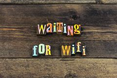 Waiting wifi internet computer signal typography type. Waiting wifi internet computer signal typography letterpress electronic web connection wireless smart stock photography