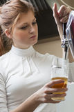 Waiting woman pouring beer Stock Photos