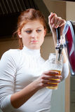Waiting woman pouring beer Stock Image