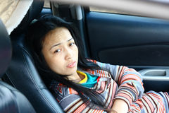 Waiting women action. Waiting woman action inside car seat Stock Images