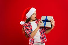Waiting for wonder. Christmas shopping. New year party. Santa claus kid. Happy winter holidays. Small girl. Present for. Xmas. Childhood. Little girl child in stock photography
