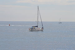 Waiting For the Yacht Race - Sailing Boat In Calm Sea Stock Photo