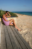 Waiting For You. Young Woman Relaxing On The Beach Of Formentera Island, Spain royalty free stock photo