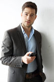 Waiting for you, call. Handsome young business man talking on the phone Royalty Free Stock Photography