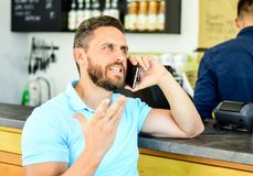 Waiting for you. Man mobile conversation cafe barista background. Drink coffee while waiting. Coffee take away option. For busy people. Man smartphone order royalty free stock photos