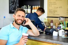Waiting for you. Man smartphone order coffee in cafe. Coffee break concept. Coffee take away option for busy people. Man. Mobile conversation cafe barista stock photography