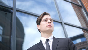 Waiting Young Businessman, Looking and Waiting for Opportunity. High quality Stock Photo