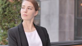 Waiting Young Businesswoman Sitting Outdoor. 4k high quality, 4k high quality stock footage