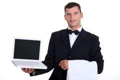 Waitor holding laptop Stock Photos